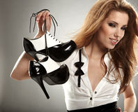 Woman after party holding shoes . Stock Photo