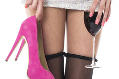 Woman Partying Holding High Heels With a Glass of Wine. Young Woman Partying Holding High Heels With a Glass of Wine Royalty Free Stock Images