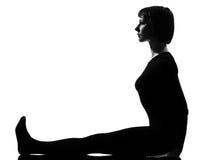 Woman paschimottanasana yoga pose Royalty Free Stock Photos