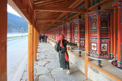 a woman passby Labuleng Temple, South of Gansu, China royalty free stock images