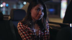 Woman passenger listening to music in a car and dancing at night stock video footage