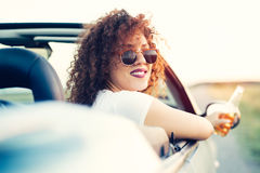 Woman Passenger On Road Trip In Convertible Car Stock Images