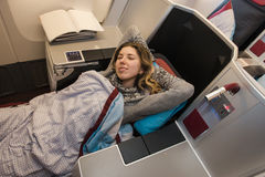 Woman passenger sleeping at the business class of airplane Stock Images