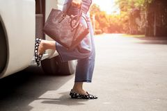 Woman Passenger With Black Hand Bag Getting Off The Bus Stock Images