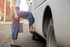 Free Woman Passenger With Stripe Hand Bag Getting On The Bus Royalty Free Stock Photos - 103038058