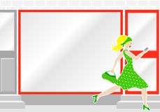 Woman passes by a shop window Royalty Free Stock Images