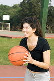 Woman Passing Basketball - vertical Royalty Free Stock Photos
