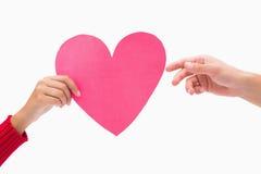 Woman passing man pink heart Stock Photos