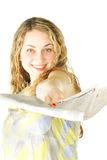 Woman passing newspaper Stock Photography