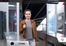 Woman passing at subway station Stock Images