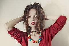 Woman with passionate look in bright beads Stock Images