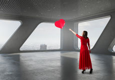 Woman in passionate red dress Stock Image