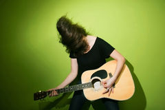 Woman passionately playing guitar Royalty Free Stock Photography