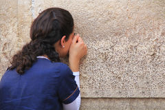 Woman Passionately Praying at the Western Wall Royalty Free Stock Photo