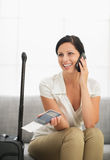Woman with passport and air ticket speaking mobile Royalty Free Stock Images