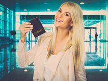 Woman with passport  in airport Royalty Free Stock Photo