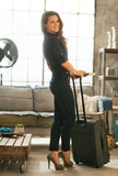 Woman with passport, ticket and luggage in room Stock Photos