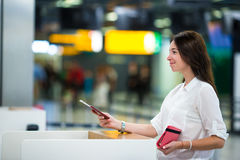 Woman with passports and boarding passes at the Royalty Free Stock Photography