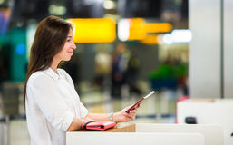 Woman with passports and boarding passes at the Stock Image