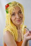 Woman with pasta on her head. Happy woman with spaghetti on her head Royalty Free Stock Photos