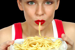 Woman With Pasta. Nice Image of a Beautiful Woman Eating Pasta on Black Stock Photography