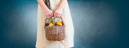 Woman Pastel Clothes with Basket Mandarines Banner Stock Photo