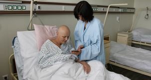 Woman patient with cancer in hospital with friend stock footage