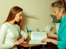 Woman patient consults specialists on sight Royalty Free Stock Photo