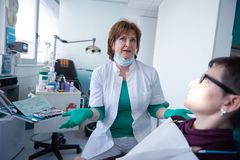 Woman patient at the dentist Stock Photo