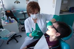 Woman patient at the dentist Royalty Free Stock Image