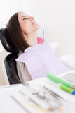 Woman patient at the dentist with instruments in the blurred fo Stock Photography