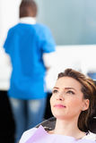 Woman patient at the dentist waiting to be checked up Royalty Free Stock Image