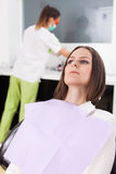Woman patient at the dentist waiting to be checked up Royalty Free Stock Photos