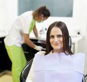 Woman patient at the dentist waiting to be checked up Royalty Free Stock Images