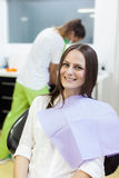 Woman patient at the dentist waiting to be checked up Stock Images