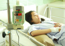 Woman patient in hospital bed with IV machine Stock Photo