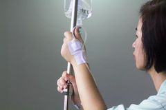 Woman patient in hospital with saline iv Royalty Free Stock Photos