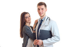 A woman patient hugs his local doctor Royalty Free Stock Photography