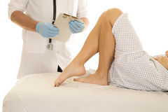 Woman patient legs doctor holding clipboard Royalty Free Stock Images