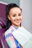 Woman patient with perfect straight white teeth waiting for dentist Royalty Free Stock Image