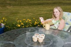 Woman on Patio with Coffee and Book Royalty Free Stock Photos