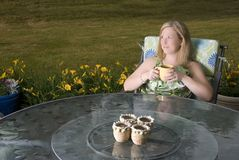 Woman on Patio with Coffee Stock Photo