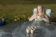 Woman on Patio with Coffee Thinking Royalty Free Stock Photography