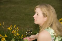Woman on Patio Drinking Wine Looking Left Royalty Free Stock Images