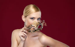 Woman with patterned masquerade mask Royalty Free Stock Image