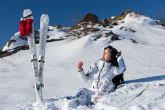 Woman Pausing from Skiing to Enjoy Warm Sunshine Stock Images