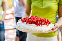 Woman with pavlova Royalty Free Stock Images
