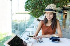 Woman pay the bill on equipment by NFC. Asian young woman Royalty Free Stock Image