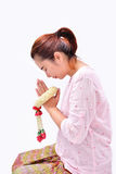 A woman pay homage with Thai traditional jasmine garland on her hands. Symbol of Mother`s day in thailand Stock Photography