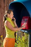 Woman  on the pay phone Stock Images